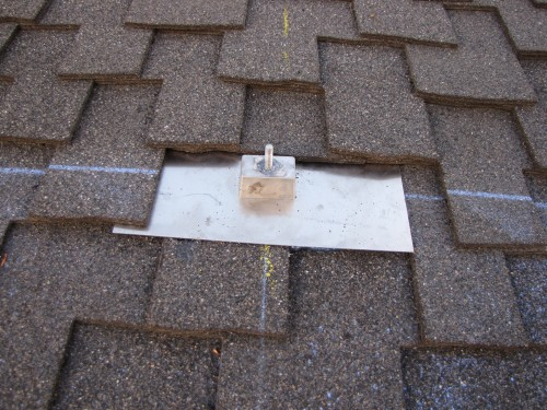 Aluminum roof mounts installed under shingles and screwed to rafters underneath