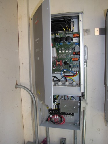 Closeup of wired inverter with door open